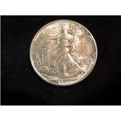 1697. 1943 P Walking Liberty Half Dollar. Toned MS 63.