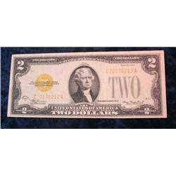 57. Series 1928D $2 U.S. Note. Seal and serial numbers have changed yellow.