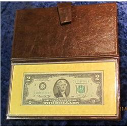 333. Series 1976 $2 U.S. Bicentennial Commemorative Note in holder.