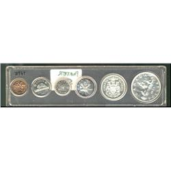 Proof-like set, 1959, in plastic year set.  An average set with lightly toned coins.  The cent is to