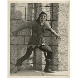 Collection of nine photos of Douglas Fairbanks Sr., from Robin Hood and The Gaucho
