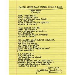 "Martin Charnin autograph manuscript lyrics to ""You're Never Fully Dressed Without a Smile"""