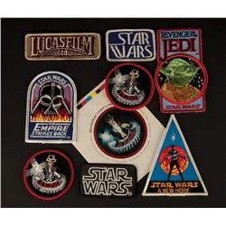Collection of Industrial Light and Magic employee Star Wars patches and car window sticker