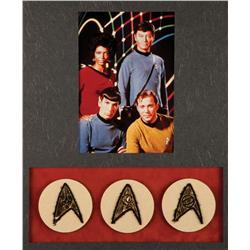 Collection of USS Enterprise Starfleet insignia patches from Star Trek: The Original Series