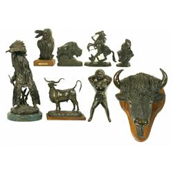 Seven Bronze Sculptures and One Iron Boot Jack