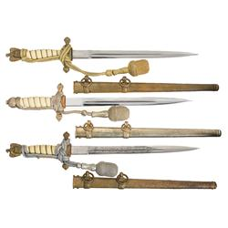 Three Kriegsmarine Daggers with Sheaths and Portapees