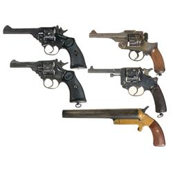 Four Double Action Revolvers and A Flare Pistol