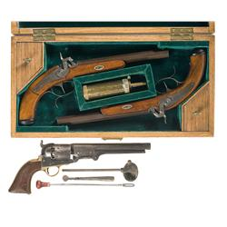 Two Cased Percussion Target Pistols and a Percussion Revolver