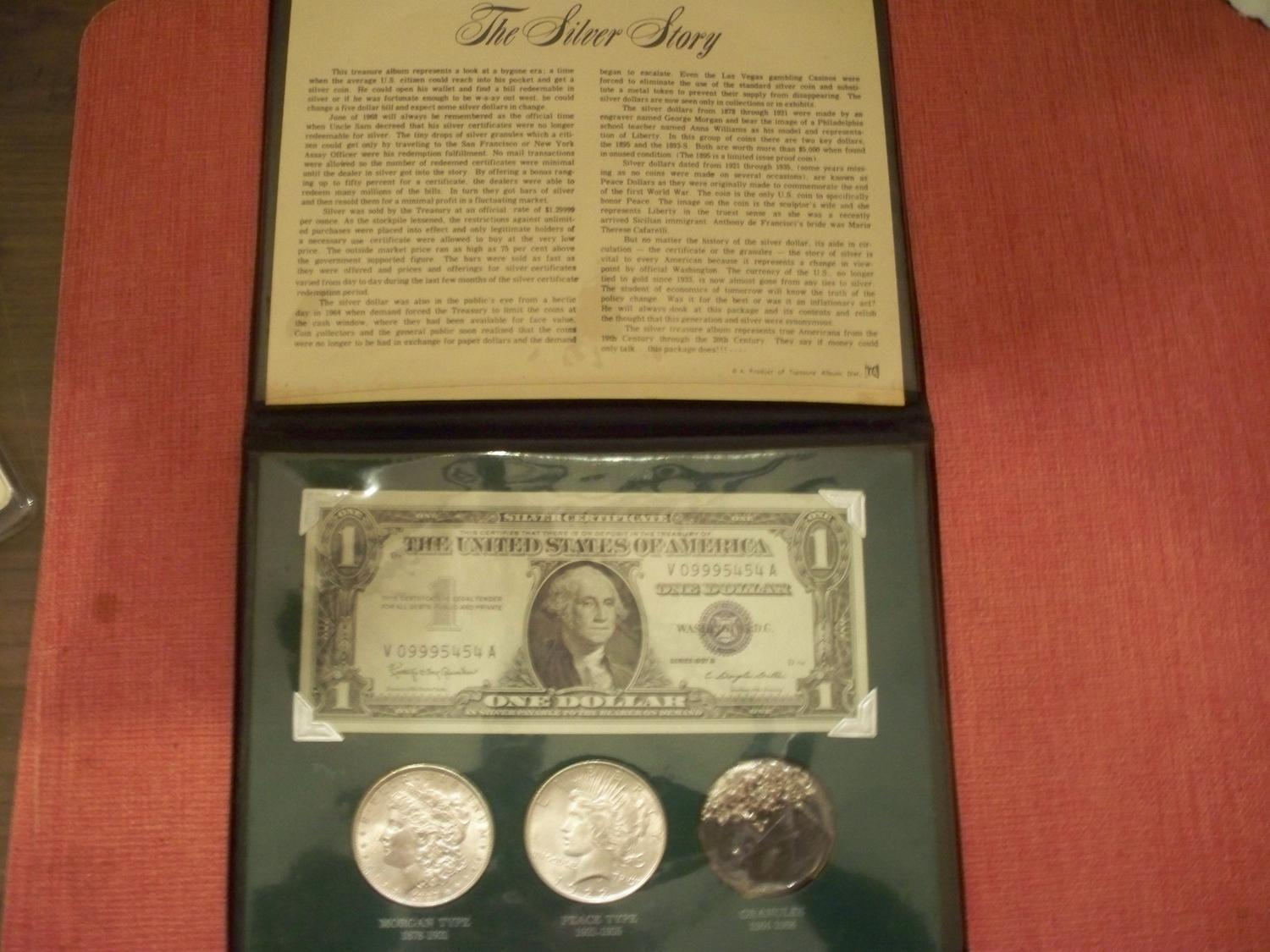 """""""The Silver Story"""" 1 Mint silver certificate, 2 BU Silver dollar coins, and silver granules"""