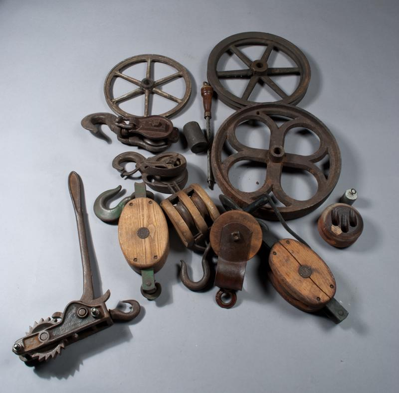 Collection of antique iron wheels and pulleys for Uses for old pulleys