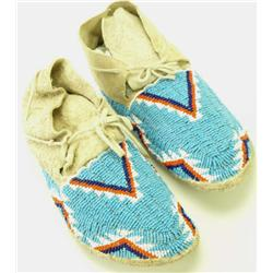 Beaded pair of moccasins hard soled and very good
