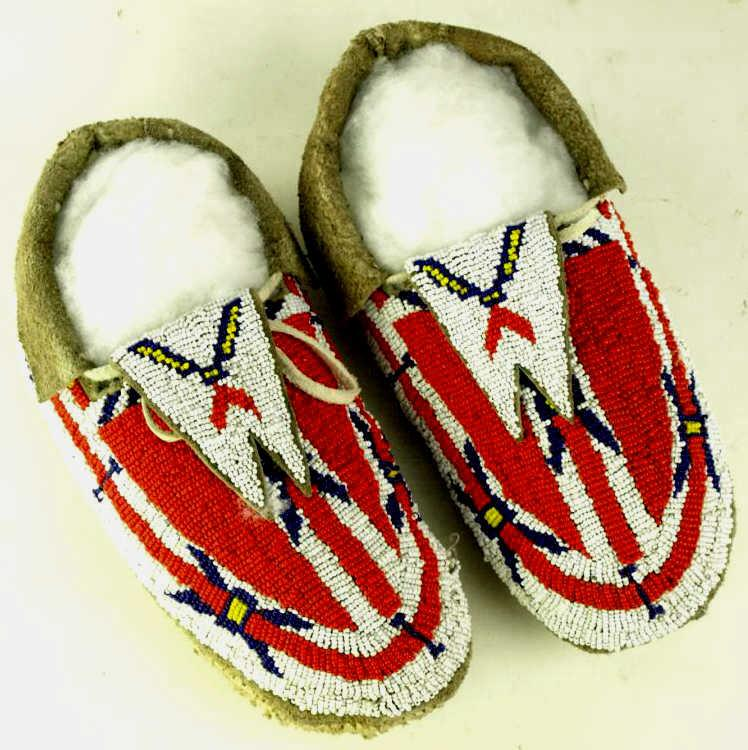 fully beaded pair of mens moccasins