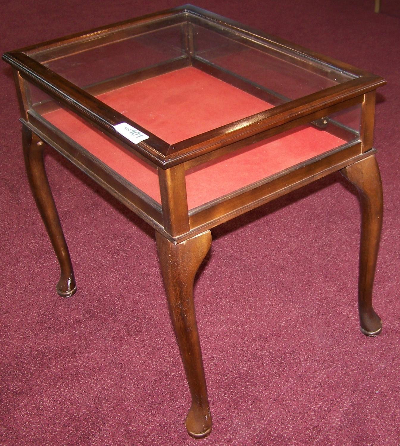 Handsome small glass wood display table