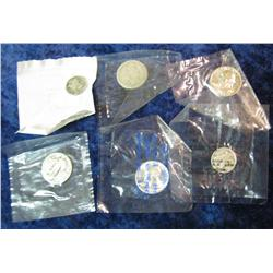 569. (2) Mercury Dimes & (4) Silver Quarters in Littleton Coin Co. packages.