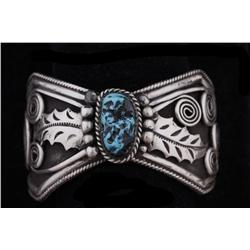 "Ladies Navajo Sterling Cuff Bracelet Center turquoise cab, signed ""Jimmy GWE"".Center turquoise cab,"