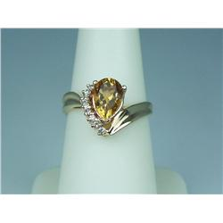 Attractive 14K YG Ladies Freeform Design Ring Set with a center Pear shape citrine weighing approx 2
