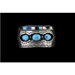 Native American Cuff Bracelet by Jim Yazzi With inset turquoise.With inset turquoise.