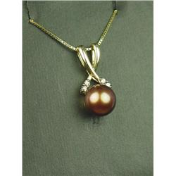 Charming 14K YG Ladies Pendant Set with a center black Pearl averaging 7.50mm in diameter and 4 side