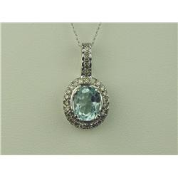 Brilliant 10K Yellow Gold Ladies Pendant Set with a center oval blue Topaz weighing approx 2.00 cara