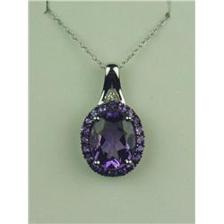 Vibrant 10K WG Ladies Pendant Set with a center Amethyst weighing approx 3.00 carats and fine set wi