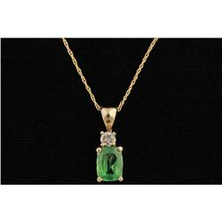 Elegant 14 YG Ladies Custom Made Pendant Set with a very fine intense green Tsavorite garnet weighin