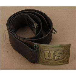"U.S. Indian War period belt-plate with  original leather belt and buckle. The buckle  is marked ""OF"""