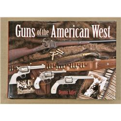 Hardback book entitled Guns of the American  West by Dennis Adler. The book remains in  good to very