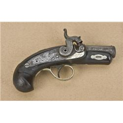Philadelphia derringer, closely copied after  Henry Deringer, with point at bottom of  escutcheon su