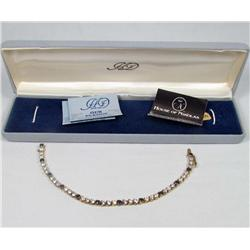 ESTATE JEWELRY - HOUSE OF NIKOLAS STERLING SILVER AND SAPPHIRE BRACELET