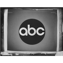 Pair of original production network logo cels for CBS and ABC