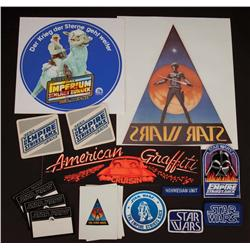 Large assortment of original Star Wars crew patches, stickers, and coasters from producer Gary Kurtz