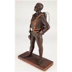 Screen-used miniature of the Lucky Lindy statue with miniature rocket pack from The Rocketeer