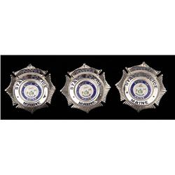 Three Maine State Police badges and Shawshank State Prison from The Shawshank Redemption