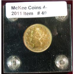 40. 1883 Gold-plated Racketeer Liberty Nickel. EF. Mounted in a