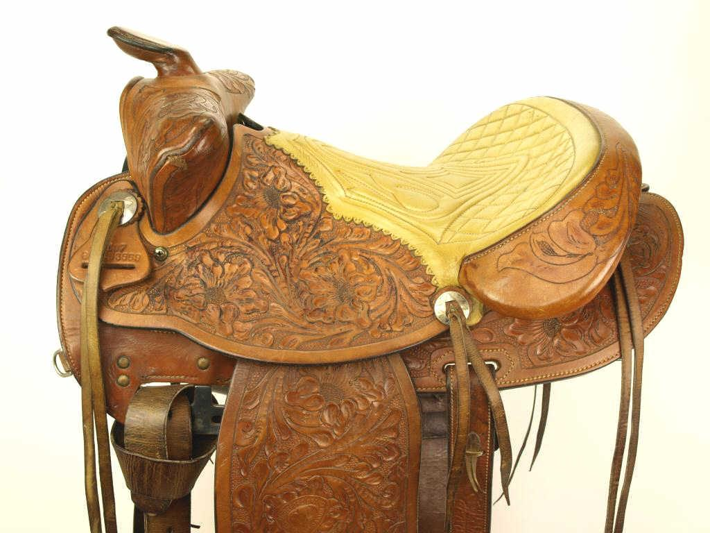 Floral carved hereford brand tex tan saddle