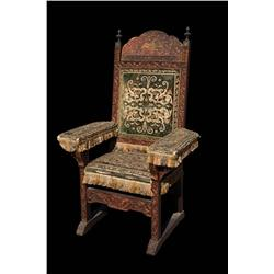 Ornately carved and tapestry-upholstered massive Russian-motif chair from TCF historical films