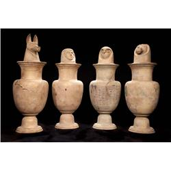 Lot of (4) monumental earth-colored Canopic jars from Cleopatra