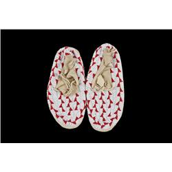 Pair of Children's Sioux Moccasins Fully beaded, red and white in color.Fully beaded, red and white