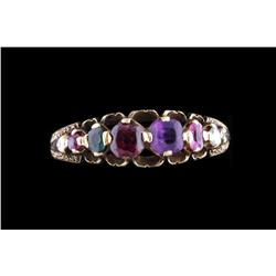 Ladies Mother's Ring Amethyst, garnet, emerald, and other stones, set in 10K yellow gold.Amethyst, g