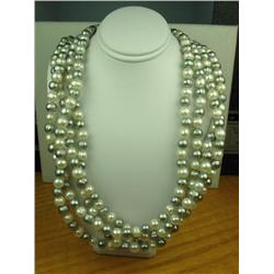 Ladies Multi-Colored Freshwater Pearl Necklace Over 80 inches in length.Over 80 inches in length.