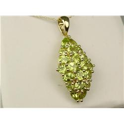 Ladies 10K YG Waterfall Design Pendant Very elegant, set with over 20 multi-shaped green peridot wei