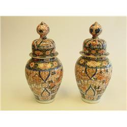 Pair Chinese porcelain lided urns
