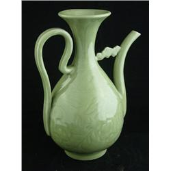 Celadon colored ewer with etched design