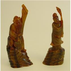 2 carved horn figures