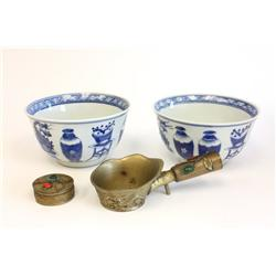 Pair blue & white bowls & bronze iron with stones