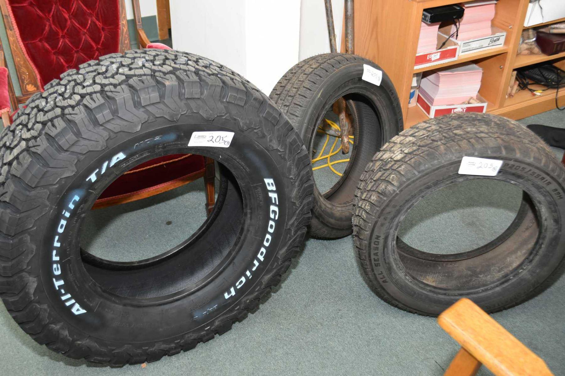 Three brand new tires including B F Goodrich All Terrain K02 LT285