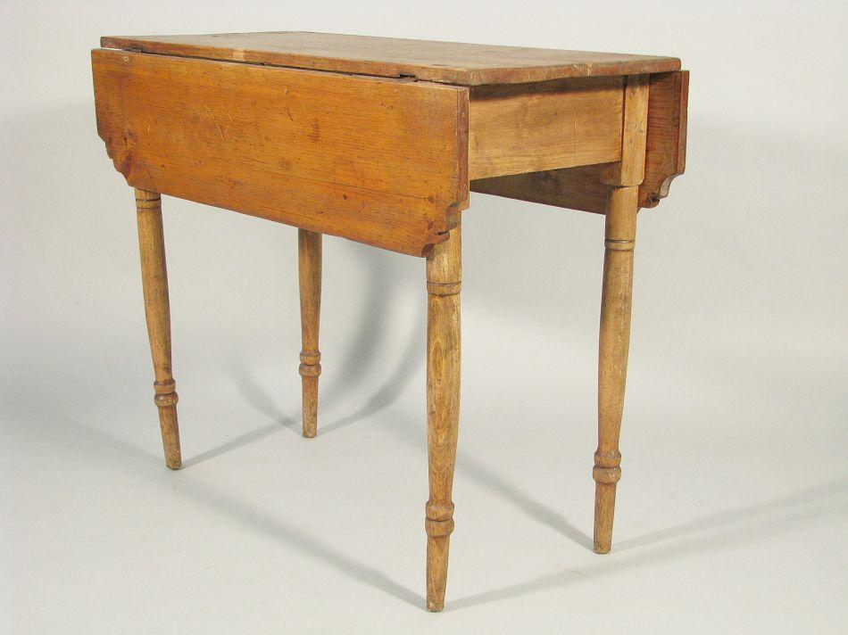Image 1 An Early 19th Century American Diminutive Pine Drop Leaf Table