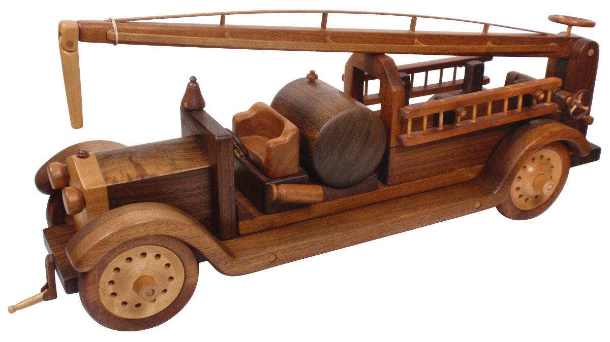 Toy fire pumper, wooden puzzle toy made to resemble the ...